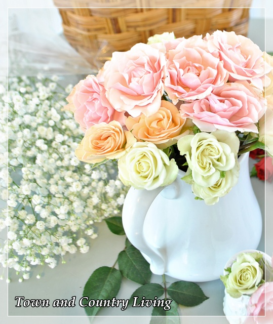Roses in white pitcher