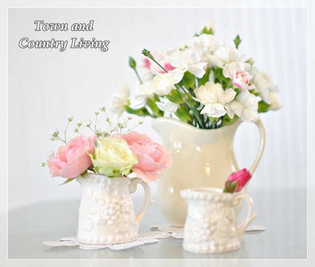 Pink and white flowers in white vases