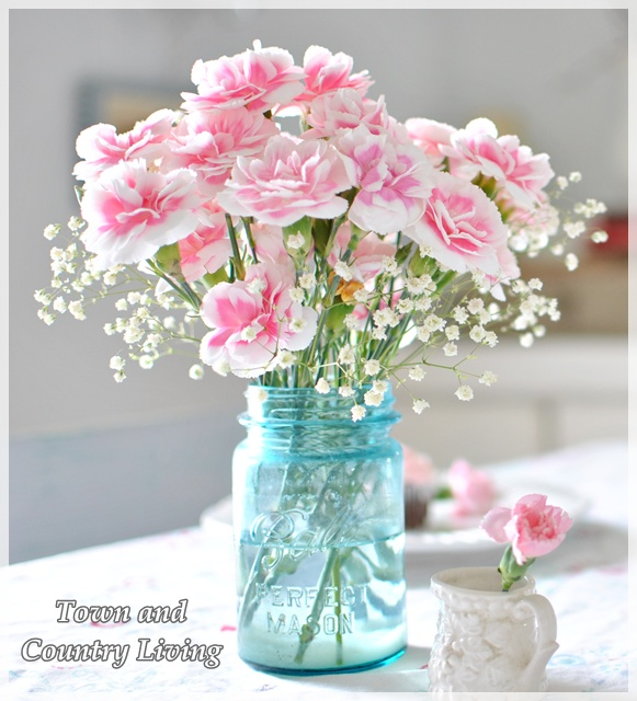 Pink Carnations in a blue mason jar