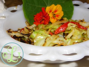 Sauteed Cabbage and Roasted Red Peppers with nasturtium blossoms
