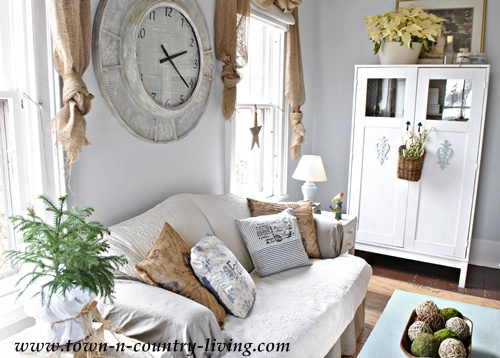 Layers of pillows and slipcovers in a country family room - www.town-n-country-living.com