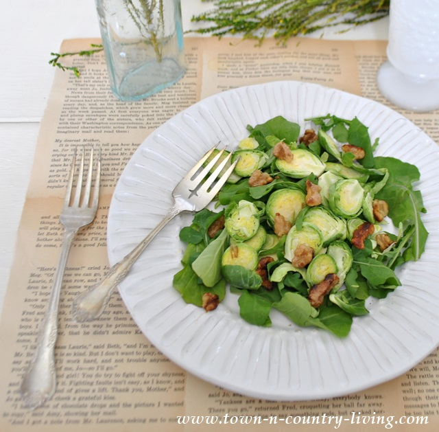 Salad with spinach, brussel sprouts, arugula, and walnuts