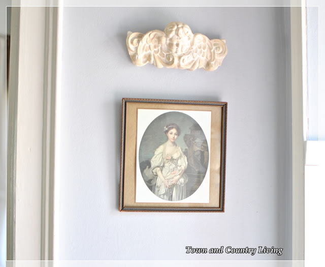 Aging plaster wall art with gesso and dark wax